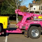 A Chappelles Towing tow truck towing a yellow late model Chevy truck in Vancouver WA