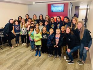 Boys and Girls Club children in a suite at a Winterhawks Game.