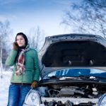 girl calls for assistance as car breaks down in snow