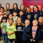 Boys and Girls Club children in a suite at a Winterhawk Game